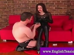 Dominatrix using cigarette to oppress