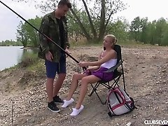 Miniskirt cutie and a horny dude fucking at the lake