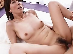 Japanese girl backs it up and sits on a guy's stiff rod