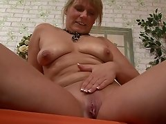 Mature blonde strokes her pink slit with a vibrator solo