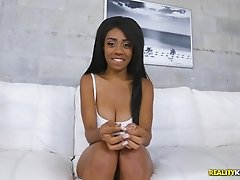 Curvy black cutie takes the white dick in the doggy style position