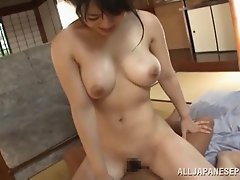 Ambitious Asian dame with natural tits giving massive dick superb handjob