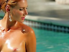 Smoldering hot Gia Marie swims then relaxes in pool nude