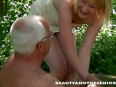 Old man eats her cunt and slides his dick into her pussy