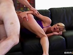 Amy Brooke has her legs pulled back and her ass reamed out
