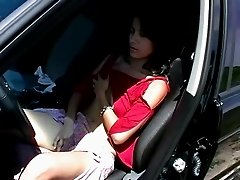 Amateur solo brunette fingering her hairy pussy in close up shoot at the car outdoor