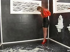 After fucking a dildo at a gloryhole she is showered with cream