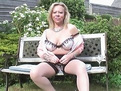 Salacious granny with tattoos  in an orgasmic toying outdoors shoot