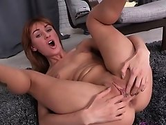Skinny model pleases herself with speculum and dildo
