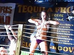 Drunk girls get topless during a wet t-shirt contest