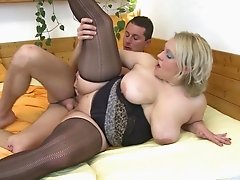 Thick mature legs look hot in stockings as she gets fucked