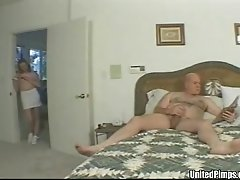 Catching her husband jerking off and helping him out