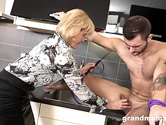 Mature blonde seductress fucks a younger guy in the kitchen