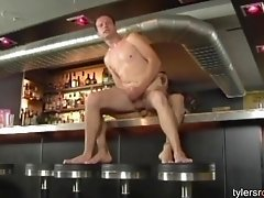 Two horny guys fucking in a bar