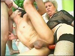 Horny granny fucks two studs hardcore in a kinky threesome