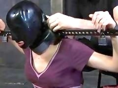 Bound babe gets rubber mask on her face BDSM porn
