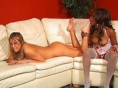 Interracial lesbian couple enjoy playing with a strapon