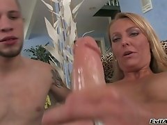 Kinky milf fucks horny dude with strapon and examines his anus with glove hands