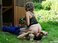 Gardener lies in the grass for hot facesitting with a BBW