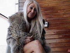 Seasoned big titty blonde in fur coat shows her wears