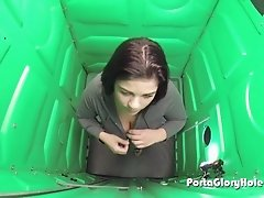 Porta Gloryhole Chubby girl getting cum in her mouth  in public park