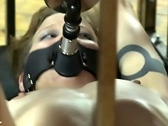 Goddess plays with her caged slave while enjoying her wine