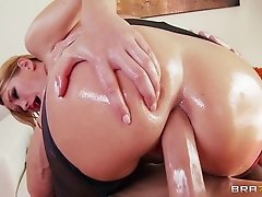 A hot blonde oils up her entire body and gets drilled in the ass