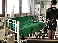 Rubber training with mistress Cheyenne de Muriel and BDSM slave