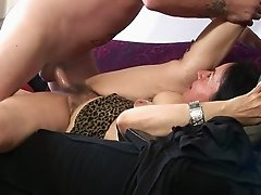 Tattooed granny with a hairy pussy enjoying an awesome missionary style fuck