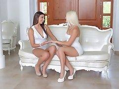 Leggy lesbian girls in high heels licking each other's sweet cunts