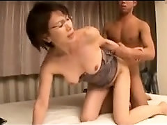 Enticing Japanese lady feeds her hungry pussy a young cock
