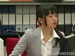 In the office this Japanese girl gets fucked on a table
