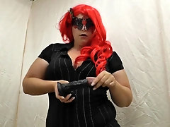 Redhead mistress uses the dildo to whip it with a cane