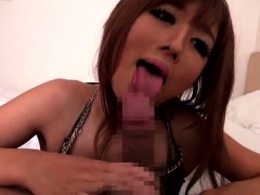Busty Japanese beauty having sex with two boys on the beach