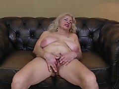 Watch Naughty granny with haired pussy masturbating indoors