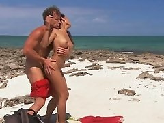 Exotic brunette loves hot bikini sex by the beach