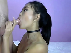 Chinese young chick swallows a big dick