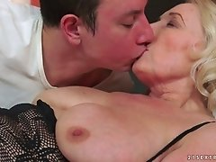 Mature granny caresses her tired boobs while savoring the pleasure of hardcore smashing