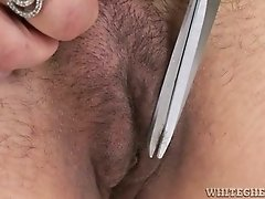 Amateur brunet chick shaving her hairy pussy