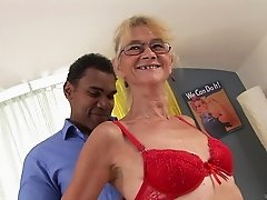A granny gets her vintage pussy fucked and jizzed in by a black guy