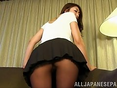 Japanese cutie wearing pantyhose shows her butt for the cam