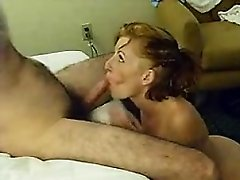 Slim redhead bobs up her head