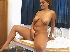 Naturally busty blond fingers her cunt and gets fucked from behind