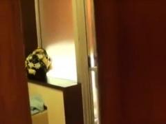 Voyeur spying on a delightful Oriental teen in the bathroom