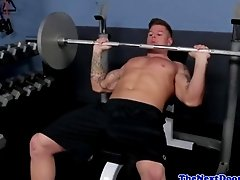 Tattooed hunk masturbates during workout