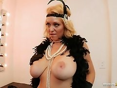 Charlee Chase, wearing stockings, lets Johnny Sins tear her cunt up