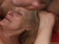 A granny takes on two guys and gets showered with jizz