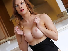 Blue eyed redhead MILF Dani strips seductively and shows off her ass