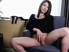 Japanese tranny dick gets hard as a rock as she strokes