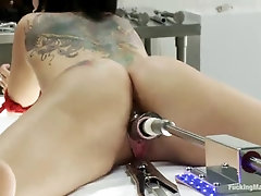 tied up tattooed brunette tori lux fucked by machine and sybian